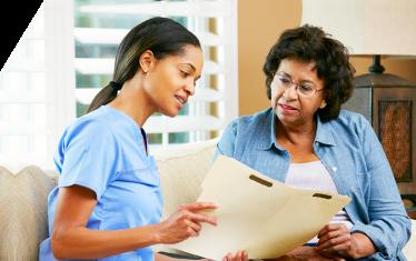caregiver showing the patient her medical result