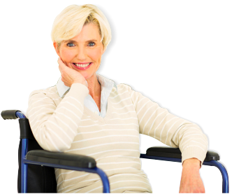 smiling patient sitting in a wheelchair